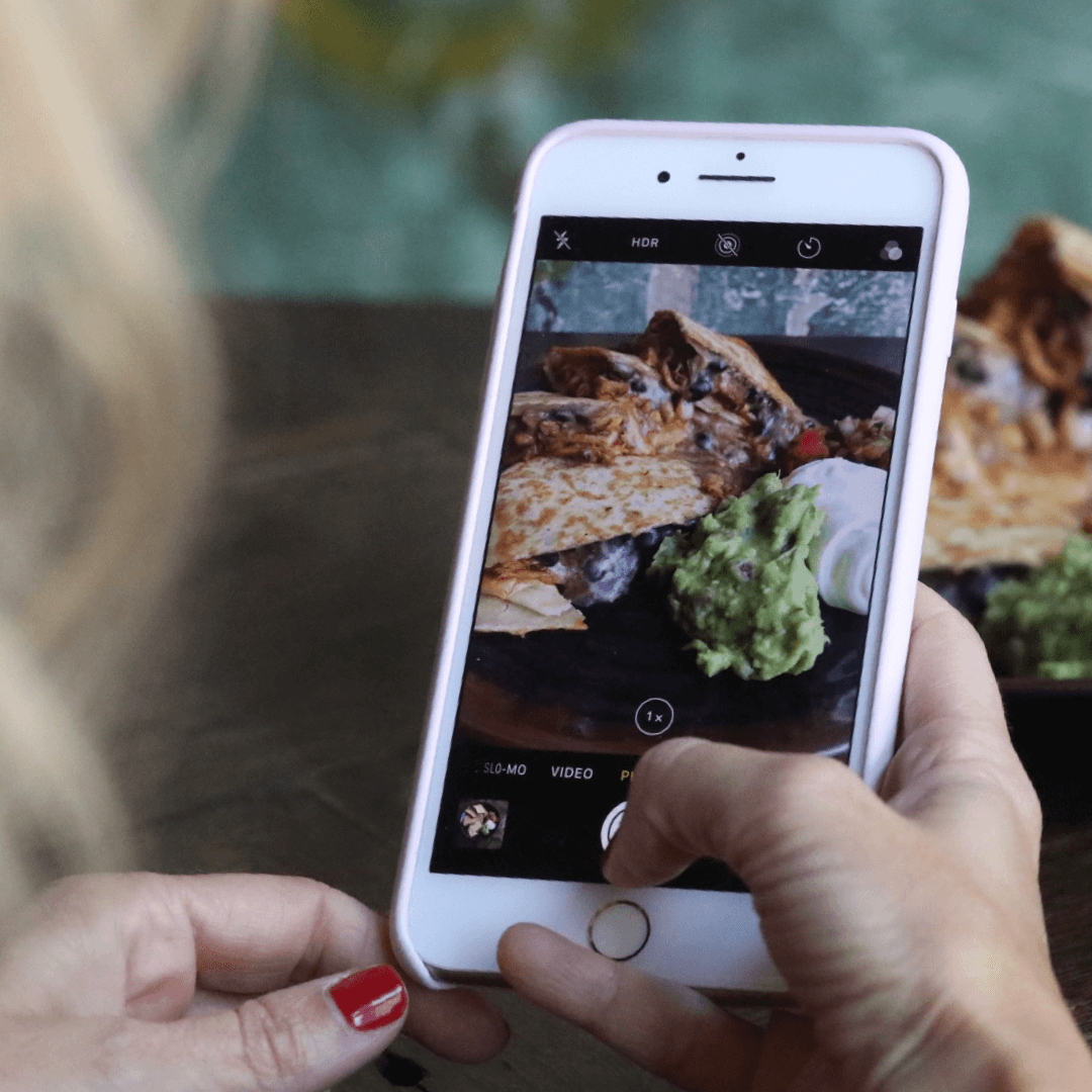 iphone taking a picture of food